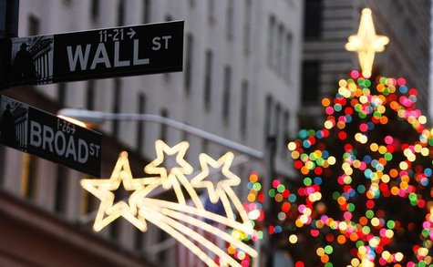 The Wall Street sign is seen in front of Christmas decorations on the first trading day of 2009 outside of the New York Stock Exchange in Ne