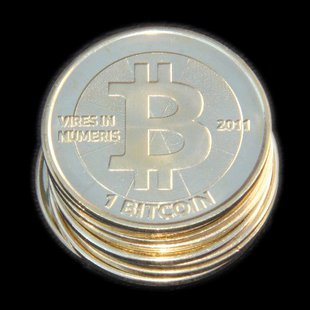 Physical Bitcoins (Photo from: Wikimedia Commons).