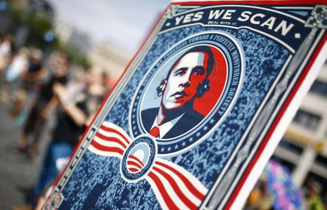 A protester holds a placard showing U.S. President Barack Obama with the phrase ''Yes we scan'' during a demonstration against the National Security Agency (NSA) and in support of U.S. whistleblower Edward Snowden in Frankfurt, July 27, 2013. CREDIT: REUTERS/ KAI PFAFFENBACH