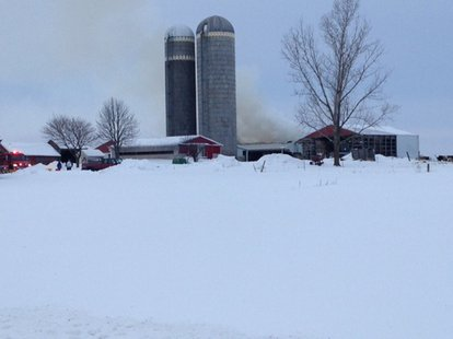 Firefighters respond to a barn fire in the village of Nichols, Tuesday, Feb. 4, 2014. (Photo from: FOX 11).