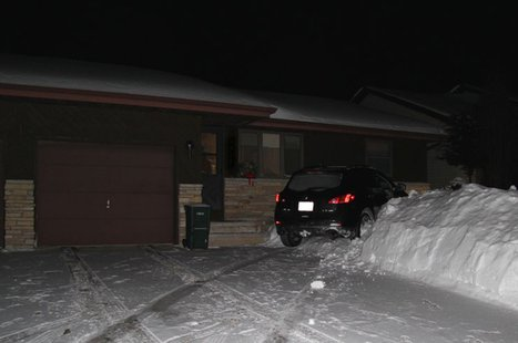 An SUV crashed into a house on the 2500 block of N. Elinor St. in Appleton, Feb. 2, 2014. (Photo: Appleton Police Dept.)