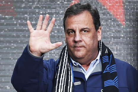 New Jersey Governor Chris Christie waves to guests as he attends the Super Bowl Hand-Off Ceremony at the Boulevard fan zone ahead of Super B