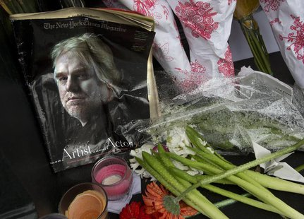 A copy of a New York Times Magazine with a photo of movie actor Philip Seymour Hoffman on the cover is pictured as part of a makeshift memor