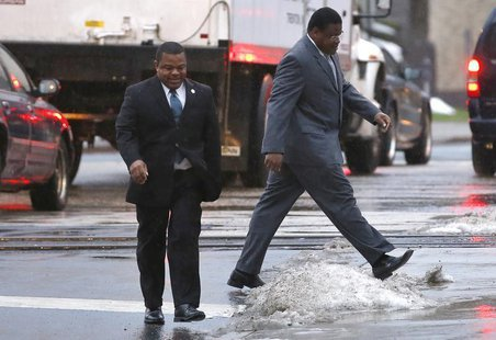Trenton New Jersey Mayor Tony Mack (left) and his brother Ralphiel Mack (right) arrive at United States Court in Trenton, New Jersey, Januar