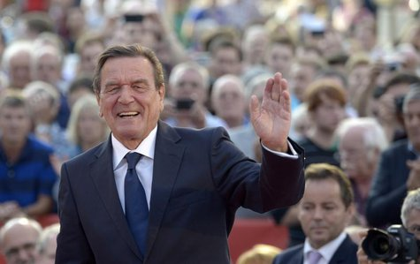 Former German Chancellor Gerhard Schroeder greets the audience as he supports Social Democratic top candidate Peer Steinbrueck (SPD) (not pi