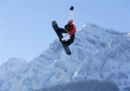 Canadian snowboarder Mark McMorris spins off a jump during slopestyle snowboard training at the 2014 Sochi Winter Olympics in Rosa Khutor, R