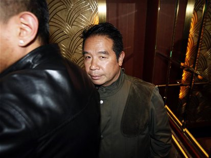 Birmingham City owner Carson Yeung stands in the lift after leaving in the middle of a general meeting at a hotel in Hong Kong February 5, 2