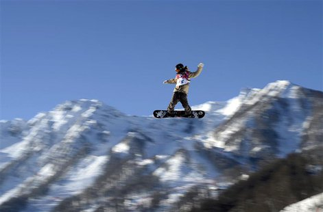 Snowboarder Roope Tonteri of Finland performs a jump during slopestyle snowboard training at the 2014 Sochi Winter Olympics in Rosa Khutor,