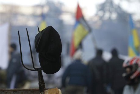 A pitchfork is seen behind anti-government protesters at the barricades in Kiev February 4, 2014. REUTERS/Vasily Fedosenko