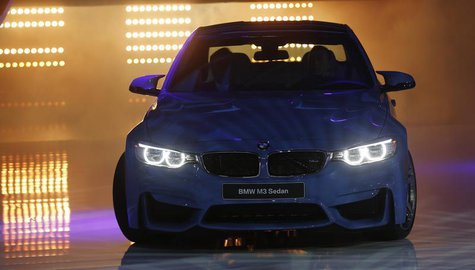 The BMW M3 sedan is rolled out during the press preview day of the North American International Auto Show in Detroit, Michigan January 13, 2