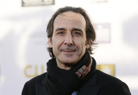 Composer Alexandre Desplat arrives at the 2013 Critic's Choice Awards in Santa Monica, California in this file photo taken January 10, 2013.