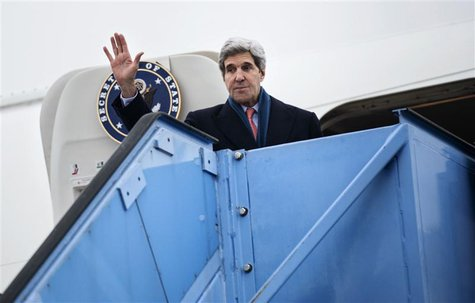 U.S. Secretary of State John Kerry waves while boarding his plane at Franz-Josef-Strauss Airport in Munich, southern Germany, February 2, 20