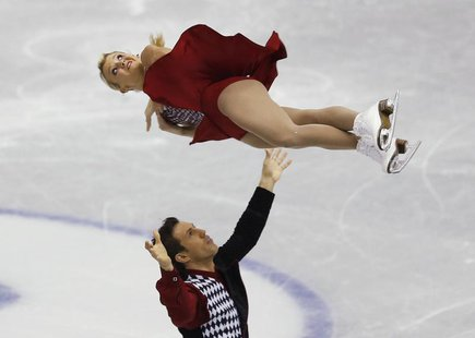 Kirsten Moore-Towers and Dylan Moscovitch of Canada perform during the pairs short programme at the ISU Grand Prix of Figure Skating Final i