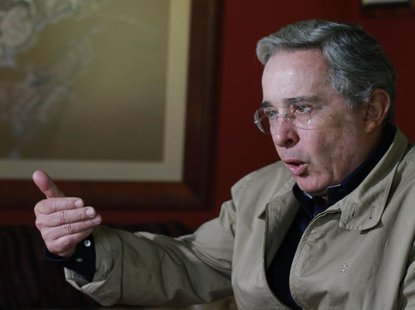 Colombia's former President Alvaro Uribe speaks during a Reuters interview at his farm house in Rionegro close to Medellin September 10, 201
