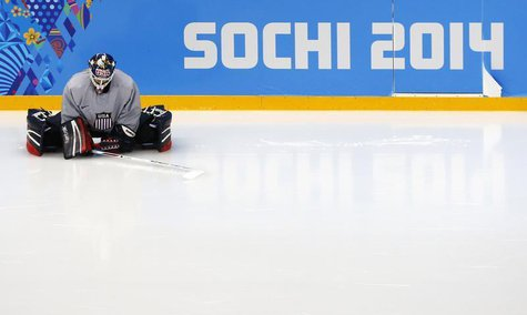Team USA goaltender Brianne McLaughlin stretches before their women's ice hockey team practice at the Shayba Arena ahead of the 2014 Sochi W