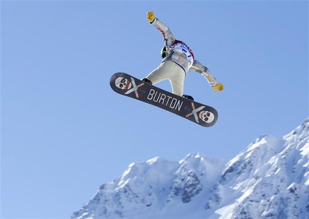 U.S. snowboarder Shaun White takes some air off a jump during a slopestyle snowboard training at the 2014 Sochi Winter Olympics in Rosa Khut