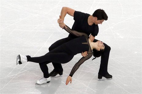 Tessa Virtue and Scott Moir of Canada skate during an ice dance figure skating training session at the Iceberg Skating Palace in preparation