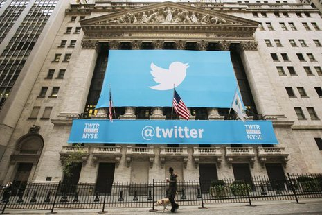 A sign displays the Twitter logo on the front of the New York Stock Exchange ahead of the company's IPO in New York, November 7, 2013. REUTE
