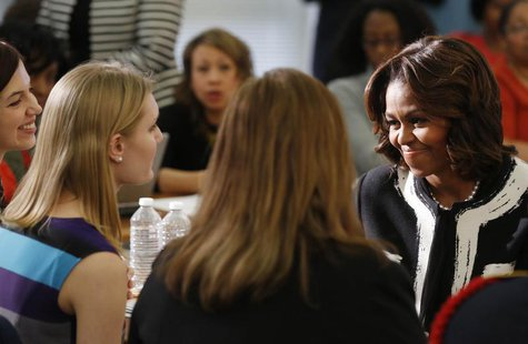 First lady Michelle Obama prepares to talk to parents and students after she delivers remarks at a Free Application for Federal Student Aid