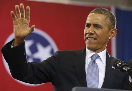 U.S. President Barack Obama waves before he speaks at McGavock High School in Nashville, January 30, 2014. REUTERS/Larry Downing