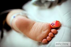 Baby with Pulse Oximetry sensor on big toe. Photo: JenFu Cheng (Flickr). The new test screens newborns for heart defects.