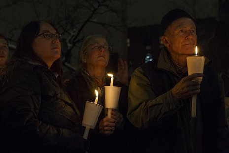 Mourners participate in a candle light vigil for late actor Phillip Seymour Hoffman in the Manhattan borough of New York February 5, 2014. R