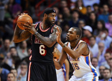 Jan 29, 2014; Miami, FL, USA; Miami Heat small forward LeBron James (6) is pressured by Oklahoma City Thunder small forward Kevin Durant (35