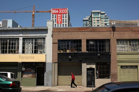 A man walks past warehouse lofts and new apartments in the South of Market area in San Francisco, California May 25, 2012. REUTERS/Robert Ga