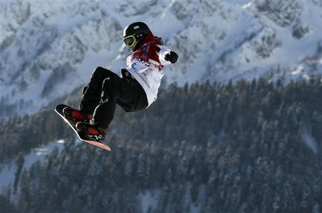 Canada's Sebastien Toutant performs a jump during the men's slopestyle snowboarding qualifying session at the 2014 Sochi Olympic Games in Ro