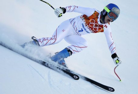 Laurenne Ross of the U.S. speeds down the course during the first training session for the women's alpine skiing downhill event at the 2014