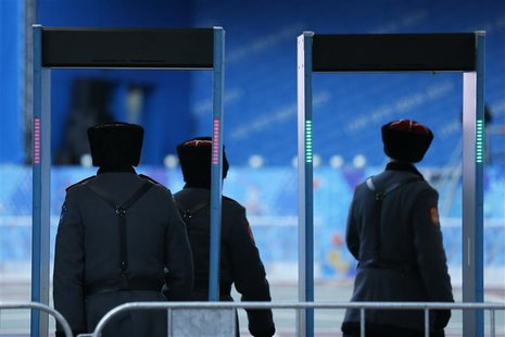Russian Cossacks enter a security checkpoint as preparations continue for the 2014 Sochi Winter Olympics in Rosa Khutor February 6, 2014. RE