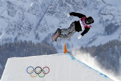 Finland's Janne Korpi performs a jump during the men's slopestyle snowboarding qualifying session at the 2014 Sochi Olympic Games in Rosa Kh