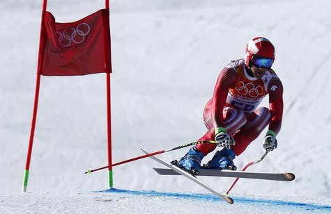 Switzerland's Didier Defago clears a gate in the first training session for the men's alpine skiing downhill event during the 2014 Sochi Win