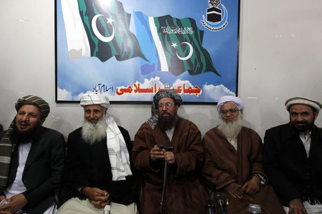Maulana Sami ul-Haq (C), one of the Taliban negotiators, flanked by his team members Ibrahim Khan (2nd L) and Maulana Abdul Aziz (2nd R), ge