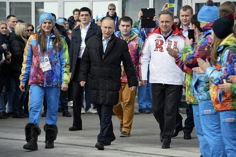 (From L to R) Olympic Village Mayor Elena Isinbaeva, Russian President Vladimir Putin and Russian Minister of Sport, Tourism and Youth polic