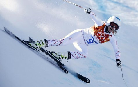 Julia Mancuso of the U.S. speeds down the course in the first training session for the women's alpine skiing downhill event during the 2014