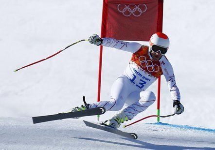 Bode Miller of the U.S. speeds down the course in the first training session for the men's alpine skiing downhill event during the 2014 Soch