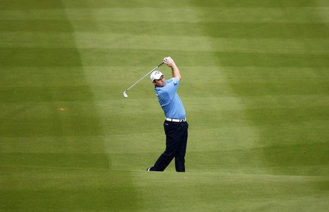 Alastair Forsyth of Scotland hits on the ninth fairway during the first round of the World Cup golf tournament in Dongguan November 26, 2009