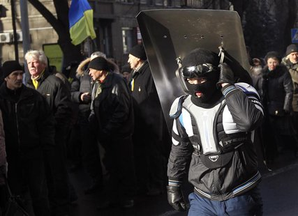 Anti-government protesters march on the street in Kiev February 6, 2014. REUTERS/Valentyn Ogirenko