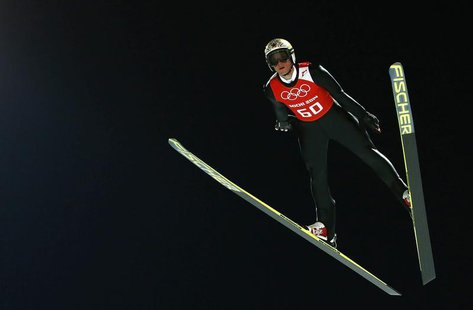 Austria's Thomas Morgenstern soars through the air during the men's ski jumping individual normal hill training event of the Sochi 2014 Wint