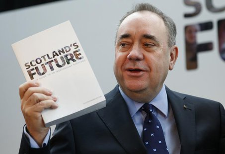 Scotland's First Minister Alex Salmond holds the referendum white paper on independence during its launch in Glasgow, Scotland November 26,