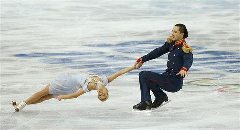 Tatiana Volosozhar and Maxim Trankov of Russia compete during the Team Pairs Short Program at the Sochi 2014 Winter Olympics, February 6, 20