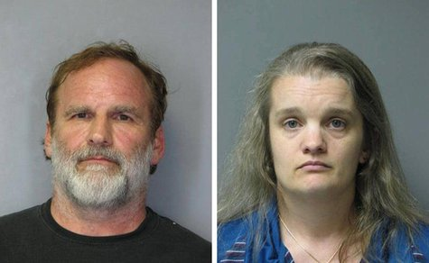 Dr. Melvin Morse, 58, and his wife Pauline, 40, are seen in this combination of booking photos released by the Delaware State Police August