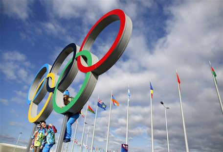 Volunteers pose for a photograph in the Olympic Rings ahead of the 2014 Sochi Winter Olympics, February 6, 2014. REUTERS/Issei Kato