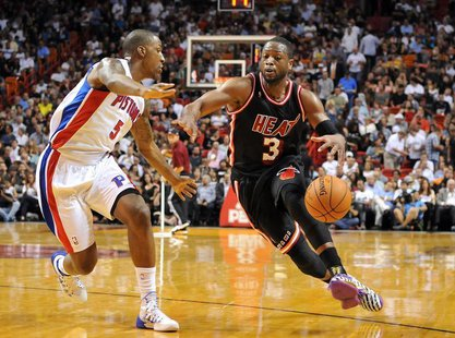Feb 3, 2014; Miami, FL, USA; Miami Heat shooting guard Dwyane Wade (3) drives to the basket as Detroit Pistons shooting guard Kentavious Cal