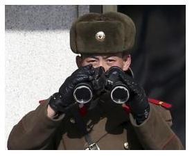 A North Korean soldier, with a pair of binoculars, observes activity in the south of the truce village of Panmunjom in the demilitarised zone separating the two Koreas, north of Seoul February 6, More... CREDIT: REUTERS/HAN JAE-HO/NEWS1