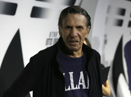 "Cast member Leonard Nimoy poses at the party for the release of the Blu-Ray DVD of ""Star Trek Into Darkness"" at the California Science Cente"