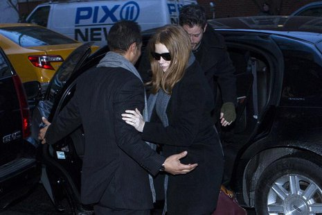 U.S. actress Amy Adams makes her way to the wake of deceased actor Phillip Seymour Hoffman in the Manhattan borough of New York February 6,