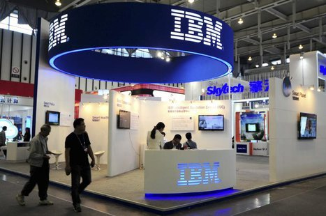 Visitors walk past the IBM booth at the 9th China International Software Product & Information Service Expo in Nanjing, Jiangsu province Sep