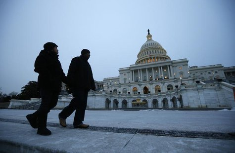 Pedestrians walk past the U.S. Capitol building prior to U.S. President Barack Obama's State of the Union address in front of the U.S. Congr